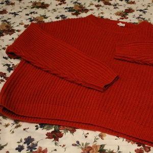 striking red sweater